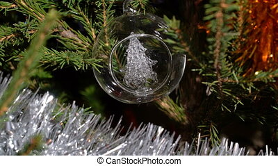 A glass christmas tree ornament - A zoom out of a nice...