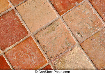 Tile floor - A nice and old traditional brown tile floor