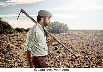 Farmer walking through the fields - Farmer of the late...