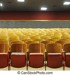 Theater Seats - Several rows of theater seats in an...