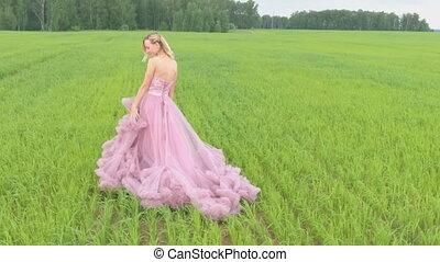 Beauty Romantic Girl standing in field