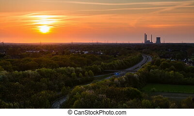 Coal Power Station And Sunset - Zooming time lapse sequence...