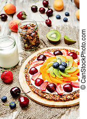 Greek yogurt granola fruit breakfast pizza toning selective...