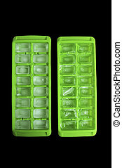 Ice Cube Trays - Two green ice cube trays isolated on pure...