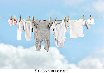 Socks and pants - Baby laundry hanging in the sky on a...