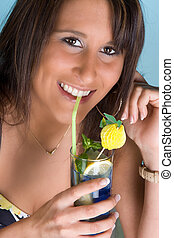 Blue cocktail - Attractive young woman drinking a blue...