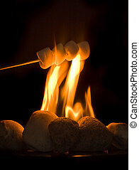 Marshmallows - Stick with four marshmallows held above...