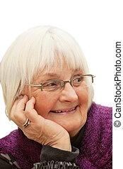 Portrait of smiling old woman looking away - Closeup...