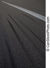 Tire Skidmarks - Tire skidmarks on an airport runway