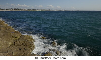 Shot over small waves around rocks 4k resolution - Shot over...