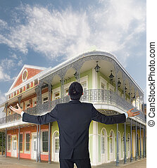 dream house - Businessman looking dream house with opened...