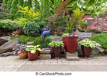 Garden Backyard Landscaping with Plants and Stone Pavers -...