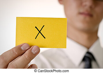 Reject pattern on yellow card hold by business man.