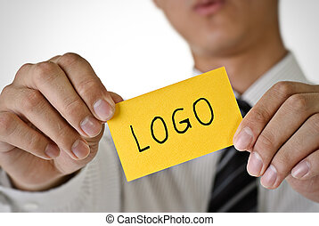 logo - Logo words on yellow card hold by business man