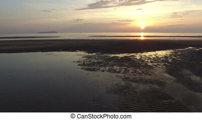 beautiful sunset above the beach - aerial view of beautiful...