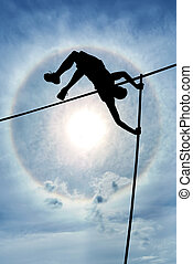 Risk taking and challenge - Long flexible pole held in the...