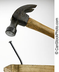 Hammer and Bent Nail - A hammer in close proximity to bent...