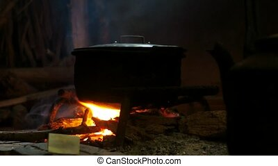 Pot Cooking Over A Fire In Room - Native place with cooking...