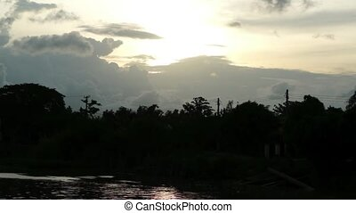 Sunset above Mekong River. Silhouette of Trees and...