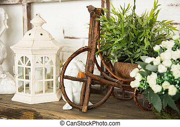 On a wooden board lamp, a ceramic angel toy bicycle and...