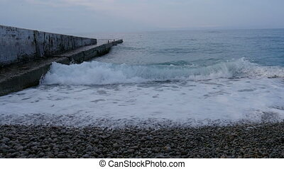 Waves washes pebble beach, the Black Sea, Crimea, Russia -...