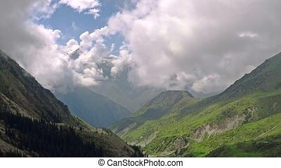 Aerial shot of summer mountain valley and clouds. Kyrgyzstan mountains