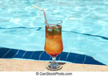 Delicious cocktail Sex on the Beach by the pool background....