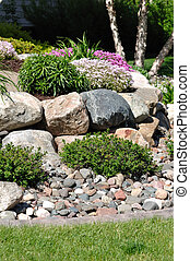 Stone Retaining Wall with Flowers and Shrubs
