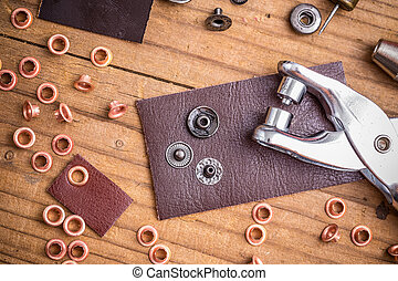 Rivets - Tailor workplace with pieces of leather and rivets
