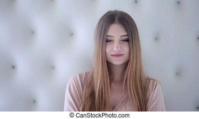 Beautiful woman posing on professional camera.