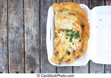 Asian cuisine - Omelet with oysters in box
