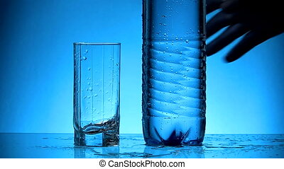 Water - Glass and plastic bottle with mineral water