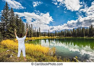 Woman, Sun Salutation on the bank of Patricia Lake - Woman,...