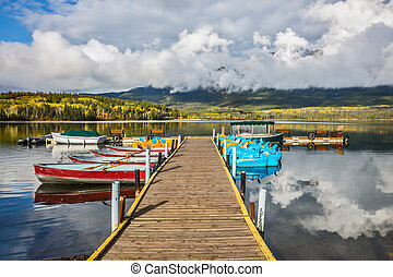 Wooden boat dock with moored boats - Pyramid Mountain...