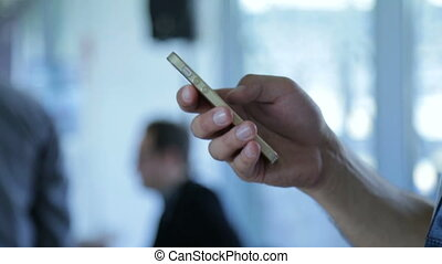 Businessman or executive man hands using smartphone