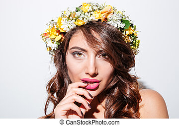 Close-up portrait of a sexy girl wearing flower diadem -...
