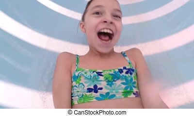 Happy little girl at aqua park - Happy little girl has into...