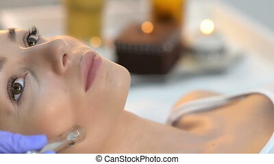 Microdermabrasion at Beauty Salon - Beautiful woman getting...