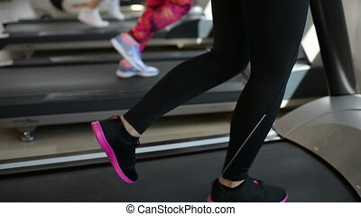 Running on Treadmill - People running on treadmill at gym