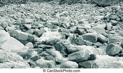 Mountain river flows on rocks, wide angle 4K video -...