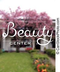 Beauty center hand lettering design inscription on blur...