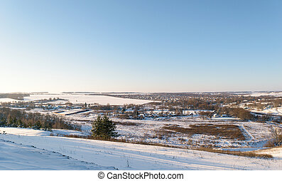 Panoramic views of the snow-covered suburban rural settlement