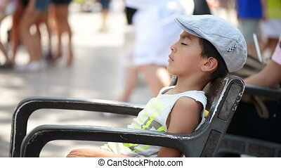 Kid Sleeping on Bench - Kid fell asleep outside on bench,...