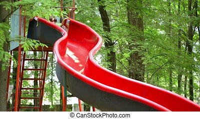 Kid Playing in Park, on a Slide