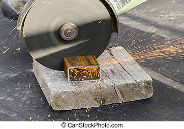 circular saw and sparks - Saw disc while cutting a railing