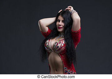 Young beautiful exotic eastern women in ethnic red dress on...