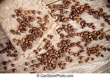 Piece of  burlap with  coffee beans