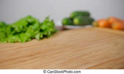 Falling Fresh Onion On Wooden Cutting Board - Falling onion...