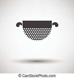Kitchen colander icon on gray background with round shadow....