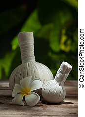 herbal compress - close up view of spa theme objects on...